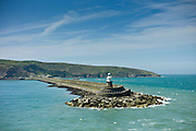 Fishguard Harbour wall and lighthouse with sea defences, Pembrokeshire, Wales, UK