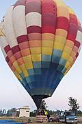A hot air balloon pilot prepares for take off in a hot air balloon in San Miguel de Allende, Mexico.