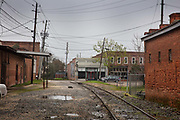 Freight rail track on 5th March 2020 in the centre of Dothan, The Peanut Capital of the World, Alabama, United States of America. The Chattahoochee and Gulf Railroadis a short line railroad operating from 2003 to 2006 between Columbus, Georgia and Dothan, Alabama, on former Central of Georgia and Norfolk Southern tracks. In 2006, the railroad was acquired by Genesee & Wyoming Inc. and combined with the adjacent H and S Railroad out of Dothan to form the Chattahoochee Bay Railroad. Commodities include chemicals, forest products, food products, and feed, which generate approximately 5,500 annual carloads.