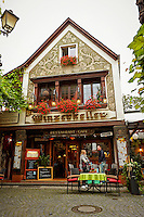 View outside of the Wizerkeller Restaurant and Cafe, Outdoor Dining, and Customers, Rüdesheim, Germany (Vertical).