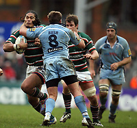 Photo: Rich Eaton.<br /> <br /> Leicester Tigers v Cardiff Blues. Heineken Cup. 13/01/2007.Alesana Tuilagi attacks for Leicester Tigers and is high tackled by Xavier Rush of Cardiff