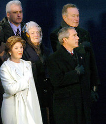 President George W. Bush and first lady Laura Bush are backed by former President George H. W. Bush and Barbara Bush during the National Anthem at the Celebration of Freedom which is part of the Inauguration festivities on Wednesday, January 19, 2005. Photo by George Bridges/KRT/ABACA.