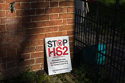 Harefield, UK. 21 January, 2020. A Stop HS2 sign outside a 16th century property due to demolished for the HS2 high-speed rail line.