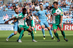Coventry City's Tony Andreu and Plymouth Argyle's Joel Grant battle for the ball