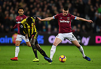 Football - 2018 / 2019 Premier League - West Ham United vs. Watford <br /> <br /> West Ham United's Declan Rice holds off the challenge from Watford's Ken Sema, at The London Stadium.<br /> <br /> COLORSPORT/ASHLEY WESTERN
