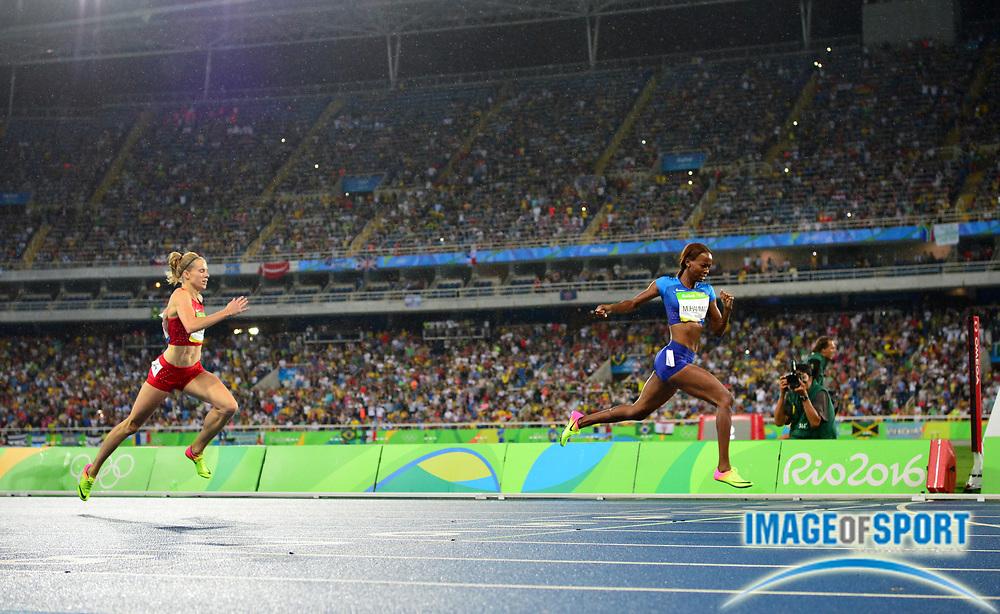 Aug 18, 2016; Rio de Janeiro, Brazil; Dalilah Muhammad (USA) defeats Sara Slott Petersen (DEN) to win the women's 400m hurdles in 53.13 during the 2016 Rio Olympics at Estadio Olimpico Joao Havelange.