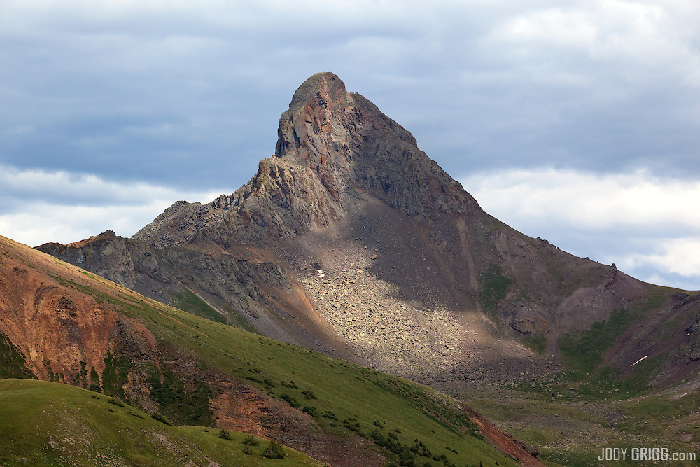 Storm clouds beging to roll in around Wetterhorn Peak 14,015ft which is located in the San Juan mountains 11 miles west of Lake City.