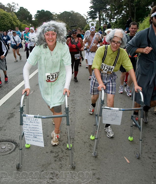 Barbara Rankin of Lodi, Calif., left, and Anousheh Fard of Rohnert Park, Calif., allude to the age of the race at the 100th running of the Bay to Breakers 12K through San Francisco, Sunday, May 15, 2011. (Photo by D. Ross Cameron)