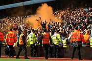 Aston Villa fans set of a flair as they celebrate after Gabriel Agbonlahor  scores a goal and makes it 1-0 . EFL Skybet championship match, Aston Villa v Birmingham city at Villa Park in Birmingham, The Midlands on Sunday 23rd April 2017.<br /> pic by Bradley Collyer, Andrew Orchard sports photography.