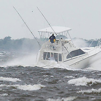 (PPAGE1) Leonardo ( Middletown) 9/18/2003  A boat battles the the rough waves of Raritan bay as it heads for the safety of the Shrewsbury river.  This was taken from Leonardo State Marina.   Michael J. Treola Staff Photographer.......MJT