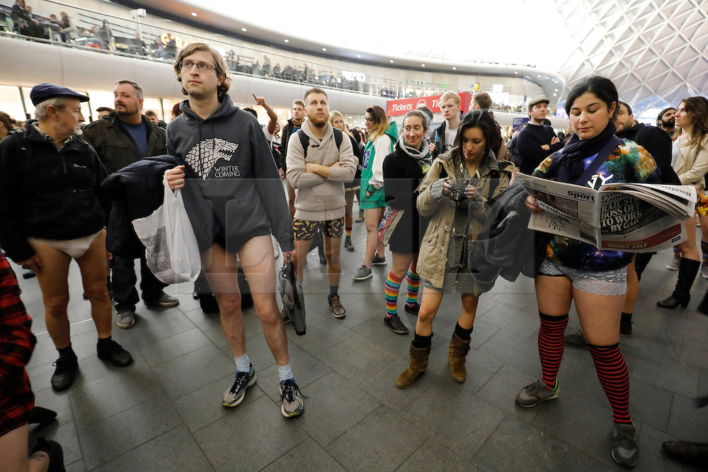 © Licensed to London News Pictures. 08/01/2017. London, UK. People take part in the annual 'No Trousers Tube Ride' event on the London Underground on Sunday, 8 January 2017 hours before a 24-hour strike action starts on the London Underground services. Participants travel on the tube without trousers as part of the event to surprise other passengers. The tradition started by a collective called 'Improv Everywhere' in New York 15 years ago. Photo credit: Tolga Akmen/LNP