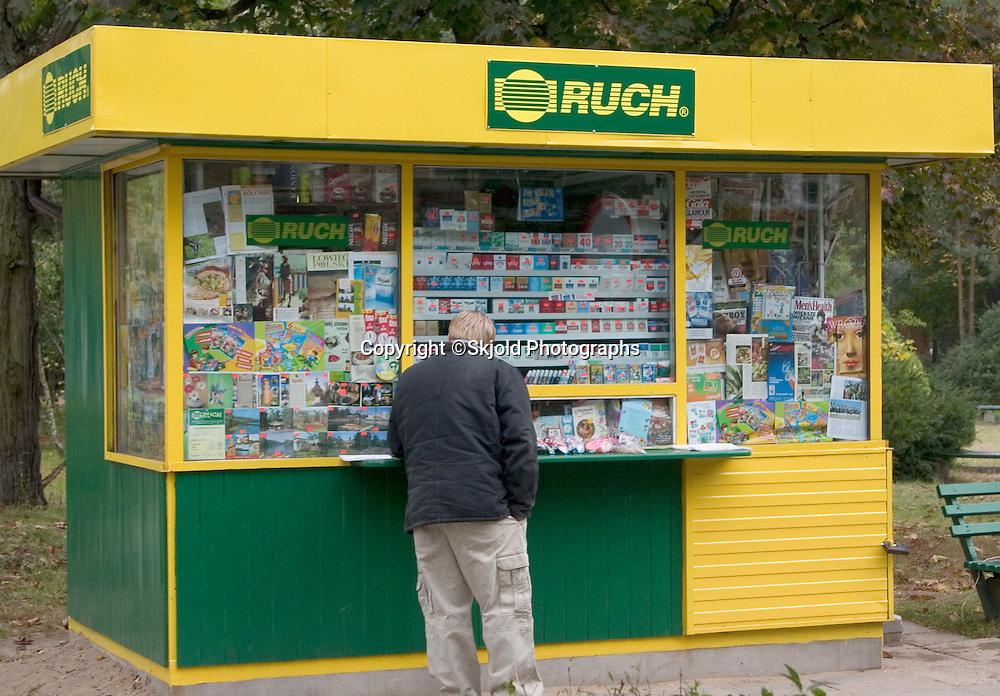 Man shopping at a Polish kiosk.   Spala   Poland