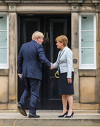 Prime Minister and Conservative Leader, Boris Johnson visits Bute House to meet First Minister of Scotland, Nicola Sturgeon. Earlier in the day, Johnson announced £300m of funding for projects to boost the economy in Scotland, Wales and Northern Ireland.<br /> <br /> Pictured: Boris Johnson and Nicola Sturgeon on the steps of Bute House