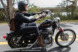 Kissa Von Addams of the Iron Lillies riding through Tomoka State Park during Daytona Bike Week 75th Anniversary event. FL, USA. Thursday March 3, 2016.  Photography ©2016 Michael Lichter.