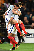 England defender John Stones is held up by England defender Kyle Walker after England scores a goal (1-0) during the FIFA World Cup Qualifier match b etween England and Slovenia at Wembley Stadium, London, England on 5 October 2017. Photo by Martin Cole.