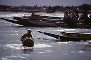 Kayar, a fishing town 60km from Dakar. Fishing has sustained generations of people, but the industry that has kept the town afloat for countless years is in danger of sinking. atches are dramatically down.