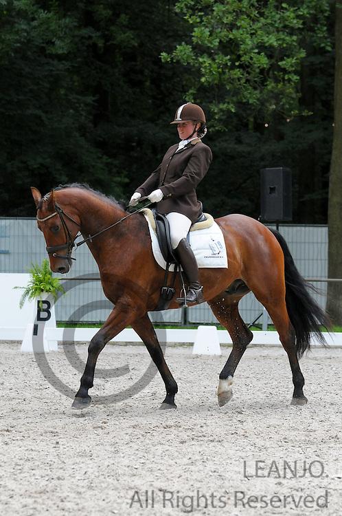 Sandra Roelevink - Adamo<br /> CHIO Rotterdam 2012<br /> © DigiShots - Esmee van Gijtenbeek