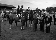 Aga Khan Trophy..1979..10.08.1979..08.10.1979..10th August 1979..The annual staging of the Aga Khan Cup took place  at the Royal Dublin Showgrounds, Ballsbridge,Dublin today.It was the first time since 1937 that Ireland won the trophy outright. The winning Irish team comprised of Paul Darragh,Capt Con Power,James Kernan and Eddie Macken..Image shows Col Ringrose, President Dr Patrick Hillery and Prof John Carroll, President of the RDS with the Aga Khan Cup.