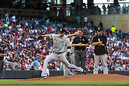 Chris Sale #49 of the Chicago White Sox takes some practice pitches as trainer Herm Schneider and manager Robin Ventura #23 look on after Sale suffered a minor injury during a game against the Minnesota Twins on June 19, 2013 at Target Field in Minneapolis, Minnesota.  The Twins defeated the White Sox 7 to 4.  Photo: Ben Krause