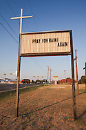 Church sign calling for prayer for rain one of many in West Texas . The Drought in Texas will have long term environmental and finical impact.