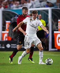 July 31, 2018 - Miami Gardens, Florida, USA - Real Madrid C.F. forward Martin Odegaard (36) moves the ball pressured by Manchester United F.C. defender Luke Shaw (23) during an International Champions Cup match between Real Madrid C.F. and Manchester United F.C. at the Hard Rock Stadium in Miami Gardens, Florida. Manchester United F.C. won the game 2-1. (Credit Image: © Mario Houben via ZUMA Wire)
