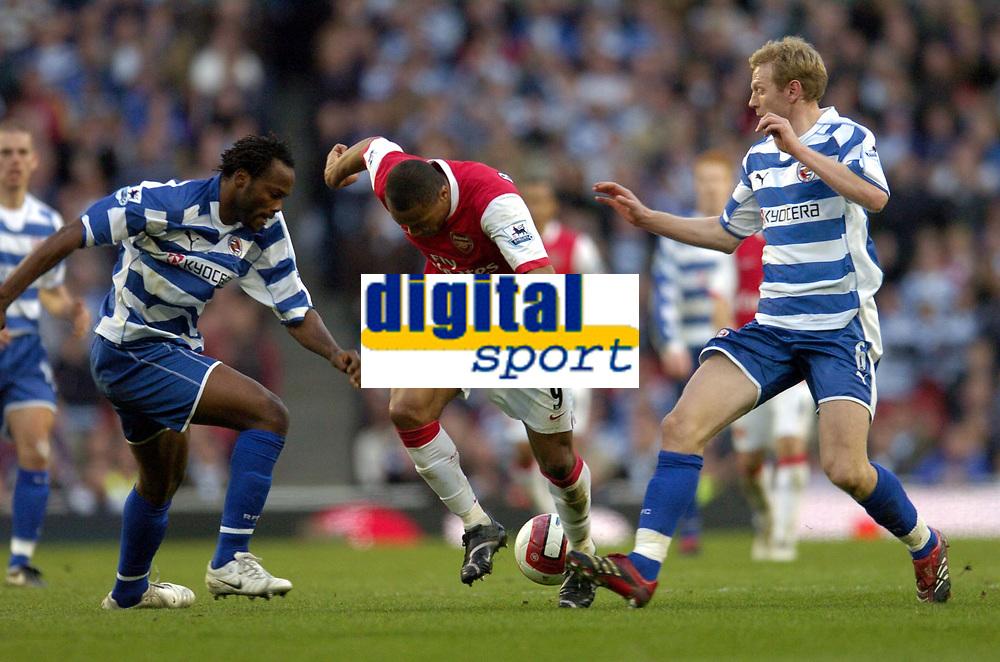 Photo: Olly Greenwood.<br />Arsenal v Reading. The Barclays Premiership. 03/03/2007. Arsenal's Julio Baptista goes past Reading's Andre Bikey and Ivan Ingimarsson