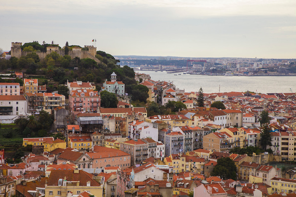 View from Graça lookout where Saint George Castle (Castelo de Sao Jorge) can be seen on the left, on the top of one of Lisbon's seven hills.