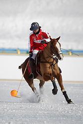 Bautista Ortiz de Urbina for team Switzerland going for the ball<br /> Match Germany - Switzerland<br /> St.Moritz Polo World Cup On Snow 2011<br /> © Dirk Caremans