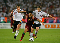 Photo: Glyn Thomas.<br />Germany v Portugal. Third Place Playoff, FIFA World Cup 2006. 08/07/2006.<br /> Portugal's Deco (C) is thwarted by Germany's Torsten Frings (R) and Sebastian Kehl.