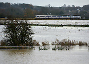 © Licensed to London News Pictures. 22/11/2012. Kings Sutton, UK A train travels from Kings Sutton surrounded by floodwater. Flooding in Oxfordshire today 22 November 2012. Heavy rain across large parts of the South West of the country has caused widespread flooding. Photo credit : Stephen Simpson/LNP