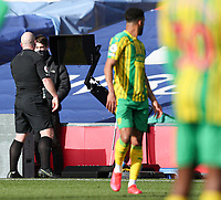 Football - 2020 /2021 Premier League - Crystal Palace vs West Bromwich Albion - Selhurst Park<br /> <br /> Referee Simon Hooper goes to the monitor to check a handball by Darnell Furlong of West Bromwich Albion