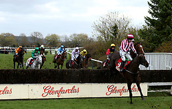 Jarob ridden by jockey Mark Enright goes over the water jump in the Glenfarclas Chase during Ladies Day of the 2019 Cheltenham Festival at Cheltenham Racecourse.