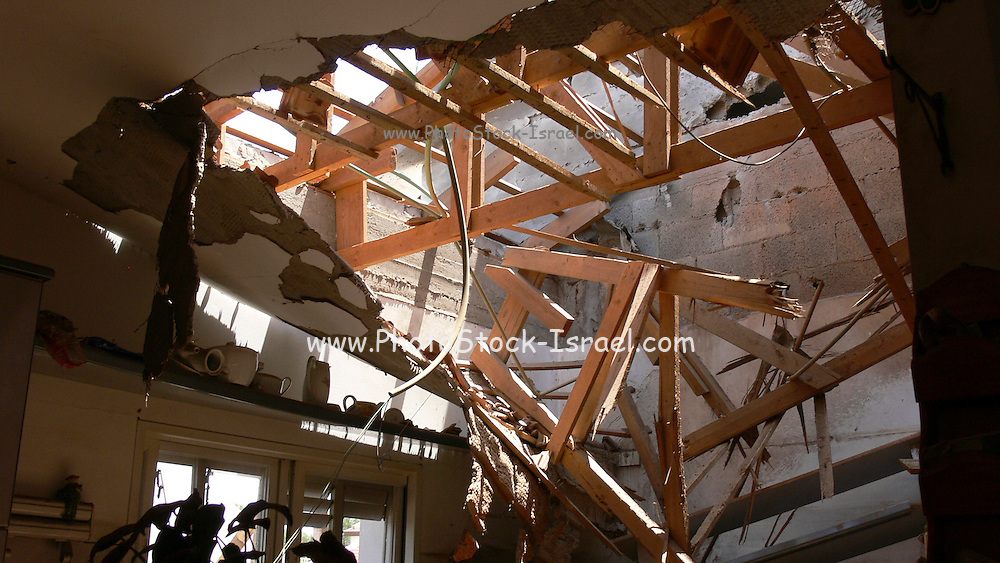 Israel, Sderot, house damaged by a Qassam rockets launched by Hamas from Gaza, collapsed roof and ceiling May 31st 2007