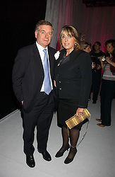 SIR NICHOLAS LLOYD and his wife EVE POLLARD at a party to celebrate the launch of You Magazine as a paid for weekly held at 2-5 Rupert Street, London W1 on 14th March 2006.<br />