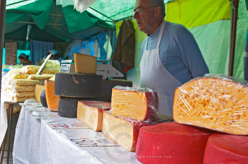A market stall street market merchant selling cheese of various size and colour Montevideo, Uruguay, South America