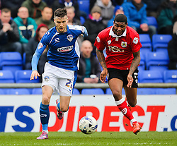 Oldham Athletic's Mat Sadler challenges Bristol City's Mark Little  - Photo mandatory by-line: Matt McNulty/JMP - Mobile: 07966 386802 - 03/04/2015 - SPORT - Football - Oldham - Boundary Park - Oldham Athletic v Bristol City - Sky Bet League One