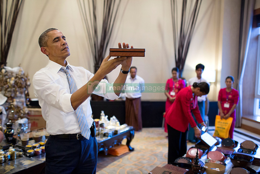 President Barack Obama shops at a vendors fair at the Kempinski Hotel Nay Pyi Taw, Naypyitaw, Burma, Nov. 13, 2014. (Official White House Photo by Pete Souza)<br /> <br /> This official White House photograph is being made available only for publication by news organizations and/or for personal use printing by the subject(s) of the photograph. The photograph may not be manipulated in any way and may not be used in commercial or political materials, advertisements, emails, products, promotions that in any way suggests approval or endorsement of the President, the First Family, or the White House.