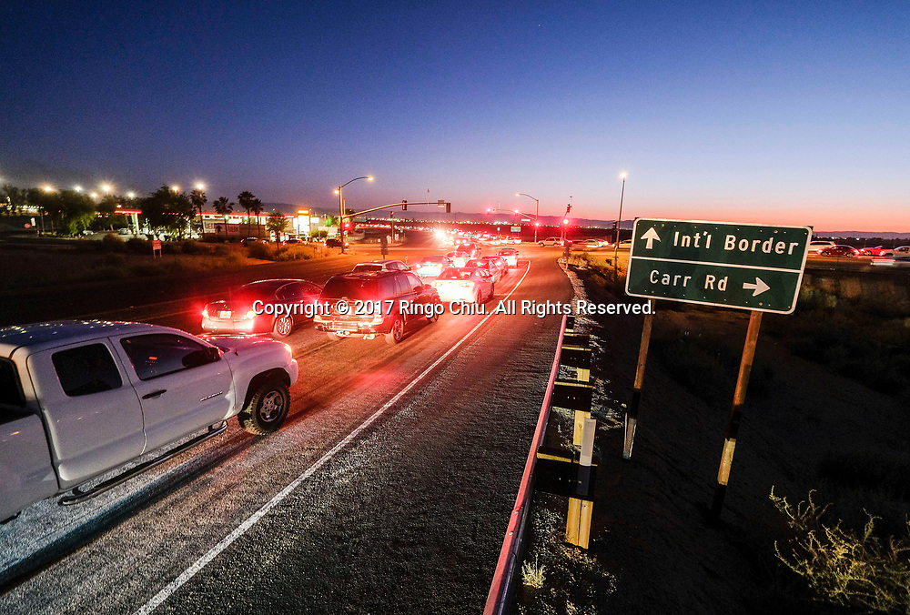 Cars wait to enter the Mexico from Calexico, California on Wednesday April 19, 2017. (Xinhua/Zhao Hanrong)