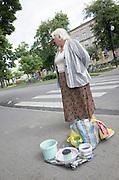 Woman selling her wares at a Polish outdoor sidewalk market rynek. Tomaszow Mazowiecki Central Poland