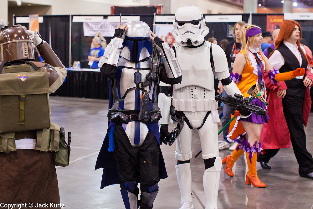 27 MAY 2011 - PHOENIX, AZ: Participants at Phoenix Comicon walk through the trade show Friday afternoon. Phoenix Comicon opened Thursday and featured a Zombie Walk through downtown Phoenix Friday night. Hundreds of people participated in the Zombie Walk, both as Zombies and as Zombie hunters. This year's Comicon includes appearances by Leonard Nimoy (Star Trek), Adam Baldwin (Firefly and Chuck), Stan Lee (Marvel Comics), Nicholas Brendon (Buffy the Vampire Slayer) and others. Activities include costuming workshops, role playing games and a Geek Prom.     Photo by Jack Kurtz