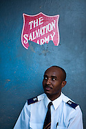 A member of the band listens to the sermon during a Sunday morning church service at a Salvation Army church in Port-au-Prince, Haiti.  Services have been held outside the building since the January 12 earthquake which rendered it unusable.