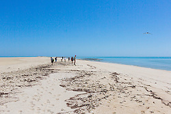 A group of tourists on the sandspit at Adele Island on the Kimberley coast.