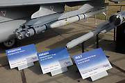 "BAE Systems Typhoon jet fighter, exhibited with missile and smart bomb systems, at the Farnborough Air Show, England. Brimstone, ASRAAM AND IRIS-T missile systems are seen in detail shown on the ground: Brimstone is an air-launched ground attack missile developed by MBDA. as is ASRAAM (Advanced Short Range Air-to-Air Missile) which is an imaging infrared homing (""heat seeking"") air-to-air missile. The IRIS-T (Infra Red Imaging System Tail/Thrust Vector-Controlled) is a German-led program to develop a short-range air-to-air missile to replace the venerable AIM-9 Sidewinder found in some of the NATO member countries."