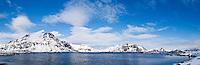 Rugged mountain peaks rise from Fjord, Vestvågøy, Lofoten islands, Norway