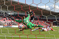 Doncaster Rovers goalkeeper Marko Marosi (13) saves close range shot at goal by Portsmouth FC midfielder Gareth Evans (26) during the EFL Sky Bet League 1 match between Doncaster Rovers and Portsmouth at the Keepmoat Stadium, Doncaster, England on 25 August 2018.Photo by Ian Lyall.