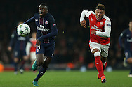 Blaise Matuidi of Paris Saint-Germain and Alex Oxlade-Chamberlain of Arsenal chase the ball. UEFA Champions league group A match, Arsenal v Paris Saint Germain at the Emirates Stadium in London on Wednesday 23rd November 2016.<br /> pic by John Patrick Fletcher, Andrew Orchard sports photography.
