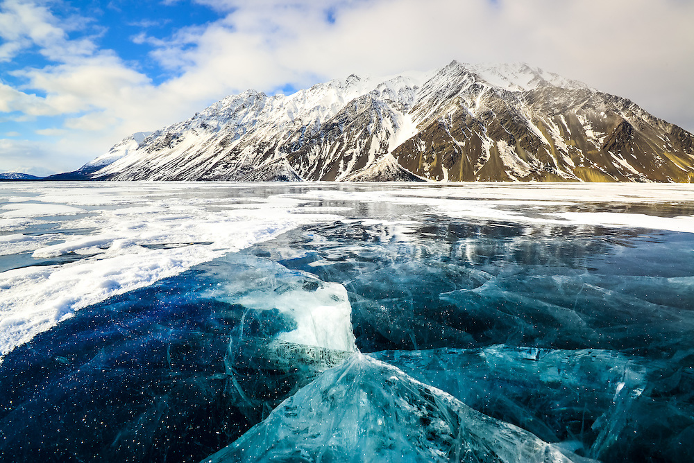 The clear, windswept ice is almost four feet thick