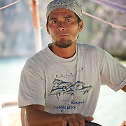 Captain and Tour Guide drives Pontoon boat in El Nido, Palawan, Philippines