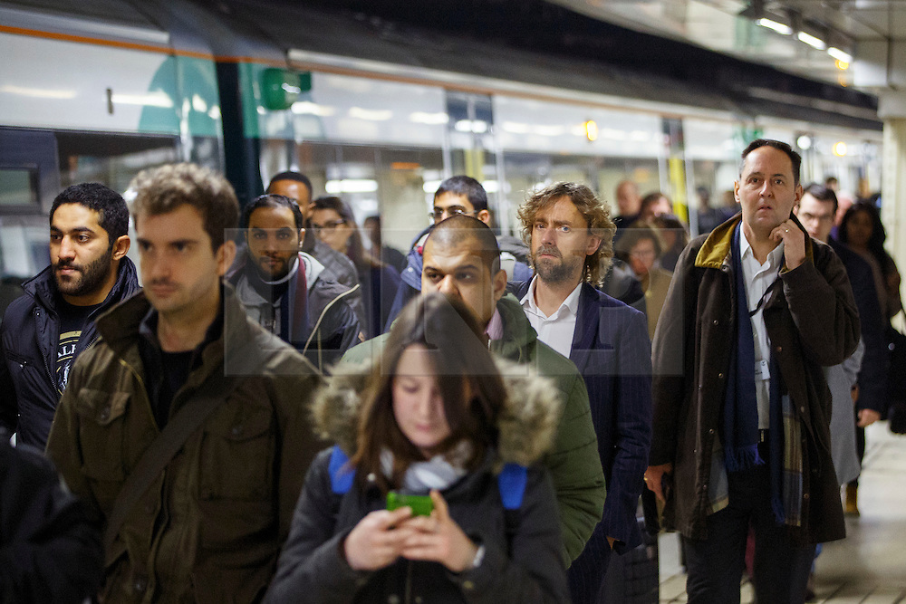 © Licensed to London News Pictures. 06/12/2016. London, UK. Southern Rail passengers arrive at Victoria Station in London on 6 December 2016, as hundreds of thousands of rail passengers face a days of travel chaos because of a 72-hour strike in an escalating dispute over the role of conductors between Southern Rail and the RMT Union. Photo credit: Tolga Akmen/LNP