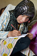 """Balkh province Afghanistan. Samarkand-Dion. A mother attending adult education class. Wadjia (12) """"I want to be a doctor. I'm in class 7 at school but I come here too to learn extra things."""""""